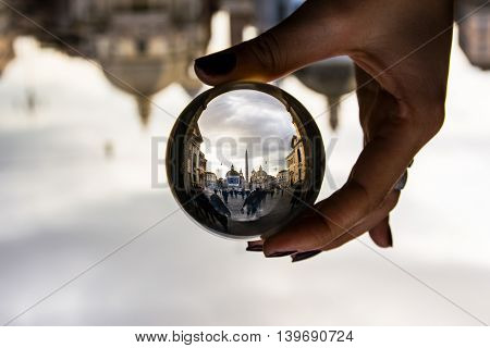 Piazza del Popolo in Rome Italy with Dramatic Clouds through Glass Sphere Perspective