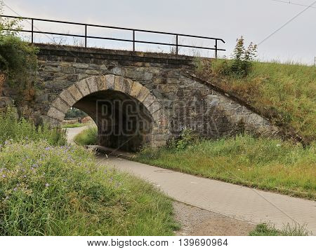 Old small stone railroad bridge in nature