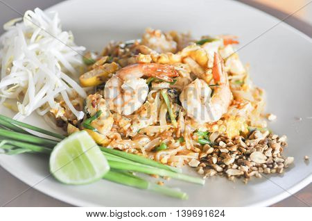 Stir-fried noodles with shrimp in Thai style or pad thai dish