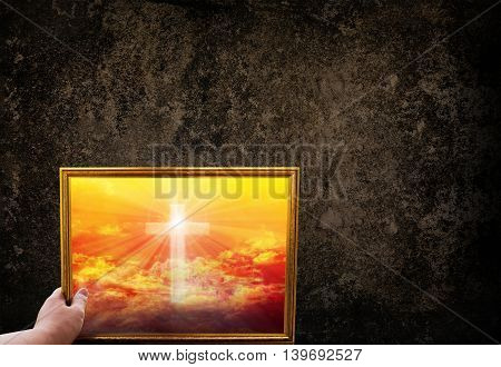 Hand Hold Picture Frame Ofcrucifix Or Cros On Golden Sky  On Dark Grunge Wall