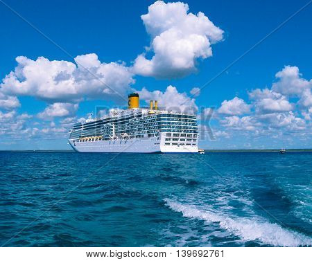 Catalina island, Dominican Republic- February 05, 2013: Costa Luminosa cruise ship, owned and operated by Costa Crociere, built by Fincantieri Marghera shipyard in 2009.