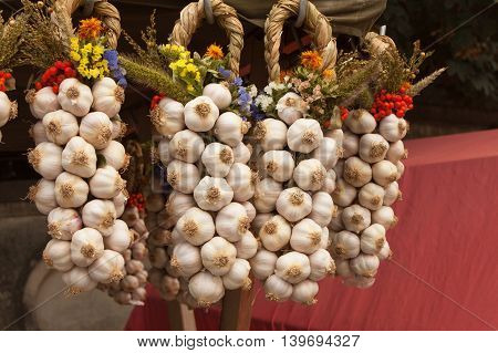 Organic garlic for sale at outdoor Farmers Market. Sales of garlic at the market.