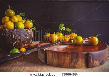 Yellow Kumquats on the old wood, fruit from VietNam