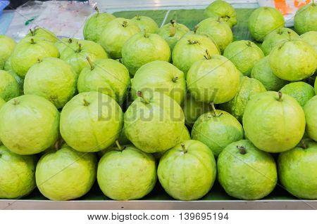 Fresh Guava in Thai Local Market background.