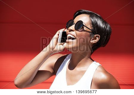 Half Profile Of Beautiful Young Woman Wearing Casual White Top And Stylish Shades With Happy Express