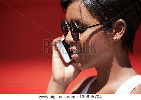 Close Up Isolated Profile Of Attractive Young Female With Perfect Healthy Skin Wearing Hipster Sungl