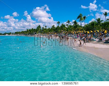 Catalina island, Dominican Republic- February 05, 2013: The views of the Caribbean Sea with coconut palms and white beaches of the tropical island of Catalina with blue sea