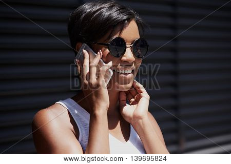 Happy Attractive Female Student Girl Wearing Round Hipster Shades Talking On Smart Phone To Her Pare
