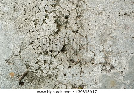 Texture of old and aged concrete wall with cracks