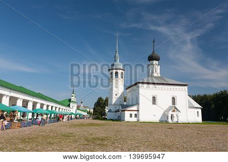 RUSSIA ,Suzdal - AUGUST 17 2011: Tourists on the central market square of Suzdal one of the most famous cities of the Golden Ring of Russia.
