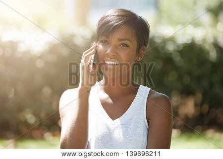 Close Up Portrait Of Successful Dark-skinned Businesswoman Dressed Casually Talking On Smart Phone T
