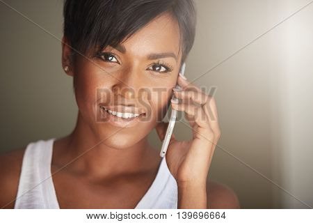 People And Technology Concept. Portrait Of Dark-skinned Woman With Brown Eyes And Short Pixie Hairst