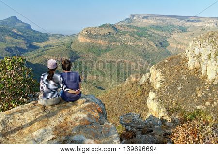 Happy couple looking at beautiful view of Blyde river canyon, travel in South Africa
