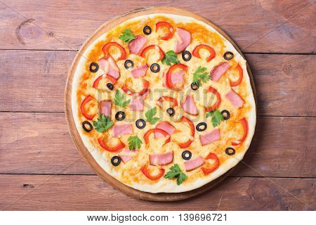 New York style pizza with pepperoni ham olives sausage & peppers . Isolated on white background with clipping path included