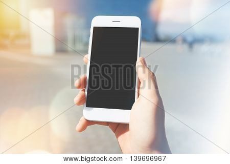Technology And Communication Concept. Cropped Shot Of A Man's Hand Holding Mobile Phone Tries To Fin