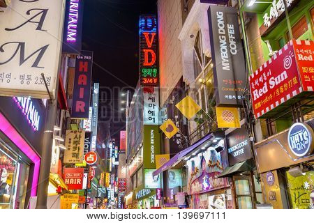 SEOUL, SOUTH KOREA - FEBRUARY 14, 2013: Neon signs line the Myeong-Dong nightlife district in Seoul.