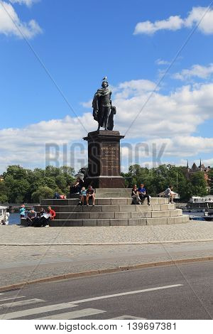 STOCKHOLM, SWEDEN - JUNE 27, 2016: This is monument to King Gustav 3 Skeppsbron on the waterfront near the Royal Palace.