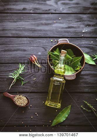 Olive oil with herbs. Mediterranean ingredients: rosemary olives thyme sage salt oregano