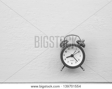 Vintage clock on wooden background Concept time to wake up