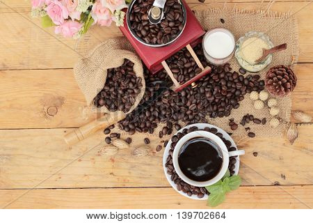 Coffee grinder with coffee beans and cup espresso