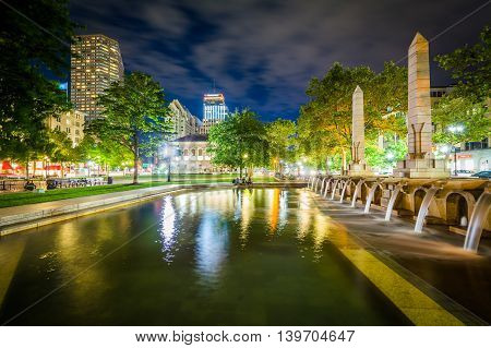 Fountains And Buildings At Copley Square At Night, In Boston, Massachusetts.