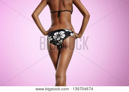 Woman From Qthe Back In Bikini With Crossed Legs