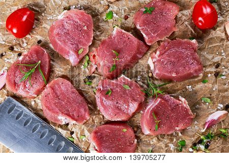 Raw pork tenderloin on crumpled paper. ready to cook