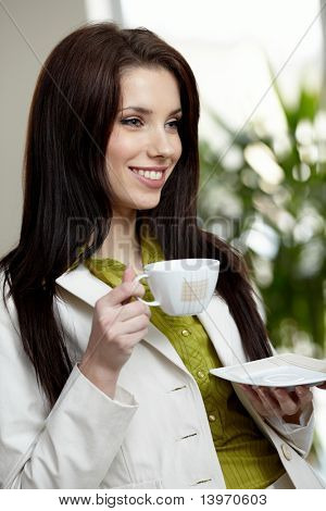 Beautiful happy business woman on blur office  background