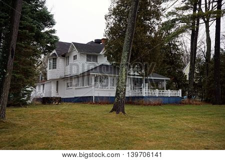WEQUENTONSING, MICHIGAN / UNITED STATES - DECEMBER 23, 2015: A white mansion on Beach Drive in Wequetonsing.