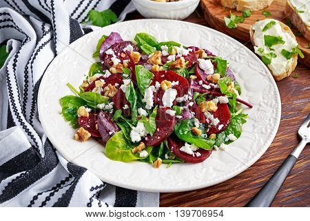Healthy Beet Salad with fresh sweet baby spinach, kale lettuce, nuts, feta cheese and toast with melted cheese.