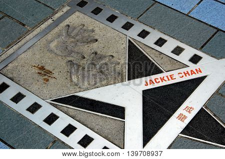 Hong Kong China - August 17 2006: Actor Jackie Chan's handprints and star on the Avenue of the Stars Promenade in Kowloon
