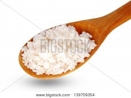 Salt on wooden spoon put on white background