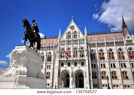 BUDAPEST HUNGARY - MAY 16: Count Gyula Andrassy Statue and Parliament building in Budapest on May 16 2016. Budapest it the capital and largest city of Hungary.