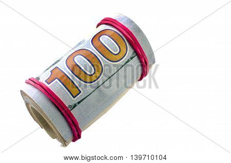 Dollars rolled into a tube on a white background. Close-up.