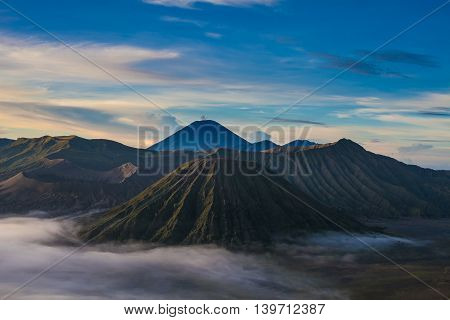 Sunrise Mountains.Asia Nature Morning Volcano Viewpoint.Mountain Trekking, Wild View Landscape.Nobody photo.Horizontal picture.First Rays Rising Sun.White Fog Background.Highly Detailed Image