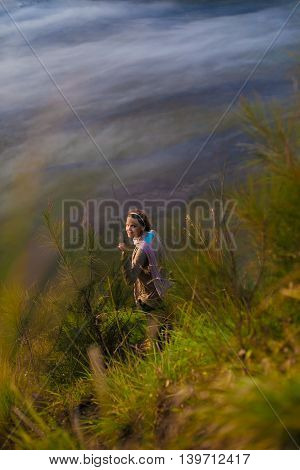 Image Young Pretty Girl Sunrise Mountains Forest.Africa Nature Morning Volcano Viewpoint.Mountain Trekking, View Landscape.Woman Traveler.Vertical Picture.First Rays Rising Sun.White Fog Background