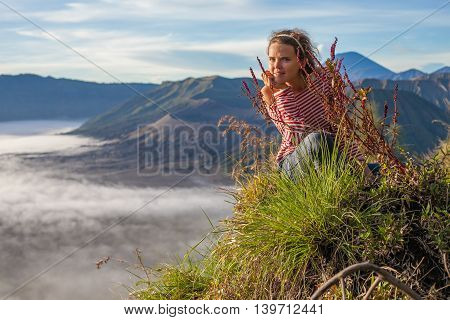 Portrait Young Pretty Girl Sunrise Landscape.Africa Nature Morning Volcano Viewpoint.Woman Engaged Yoga Meditation Practice Mountains Dawn.Mountain Trekking.Horizontal picture.First Rays Rising Sun
