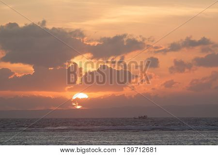 Picture of empty long tail boat on tropical beach at sunset. Ko li pe island