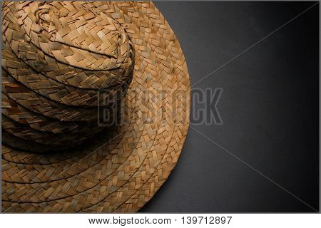 Village hat, made of straw with a gray background