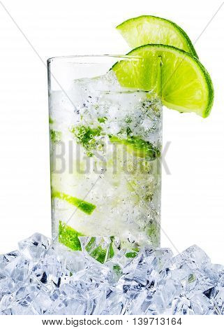 Misted glass of the water with lime and ice isolated on white background