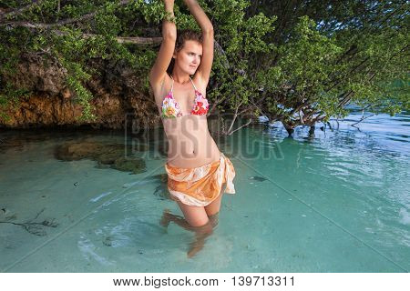 Photo Sexy Girl Posing Sea Beach Bikini. Smiling Woman Spending Chill Time Outdoor Summer. Caribbean Ocean Vacations. Horizontal, Blurred Background
