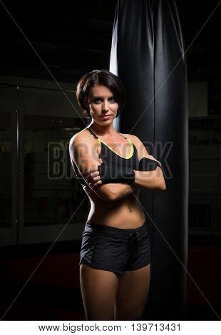 Young kickboxer woman at gym