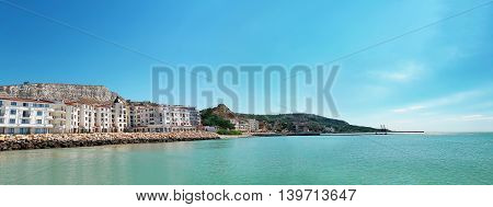 Clear morning scene with a hotel on the seashore. Panoramic view of the coast of Black Sea Balchik city Bulgaria