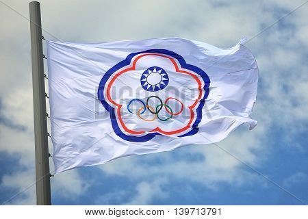 The Olympic flag of the Chinese Taipei against the blue sky