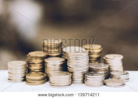 Photo coins for your business on the wood background.