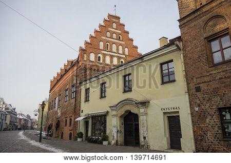 Kaunas, Lithuania - January 3, 2016: Street view of Kaunas old city with brick medieval traditional houses.