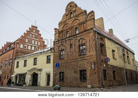 Kaunas, Lithuania - January 3, 2016: Street view of Kaunas old city with brick medieval traditional houses.