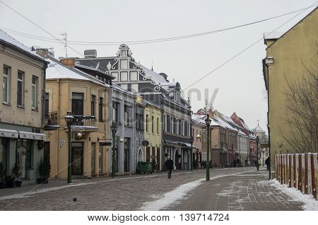 Kaunas, Lithuania - January 3, 2016: Street view of Kaunas old city and houses at pedestrian Vilniaus street.