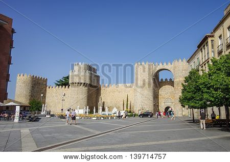 Avilaб Spain - August 23 2012: Gate Puerta del Alcazar of the medieval walls of Avila. View from Plaza Santa Teresa de Jesus. Castilla y Leon Spain Europe