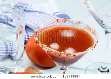 Bloody Mary cocktails on a blue wooden table